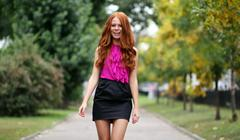 Beautiful redhead woman in a dress Stock Photos