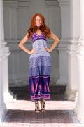 beautiful redhead woman in a dress - stock photo
