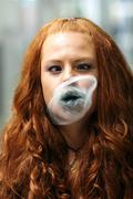 girl blowing bubble from chewing gum - stock photo