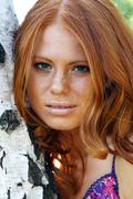Portrait of red-haired beautiful young woman Stock Photos