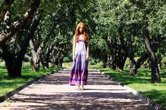 Stock Photo of beautiful redhead woman in a dress