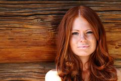 portrait of the beautiful red-haired girl - stock photo