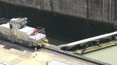Mule locomotives close up Panama Canal miraflores locks Stock Footage