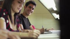 Happy student studying and writing, portrait of young man doing homework Stock Footage