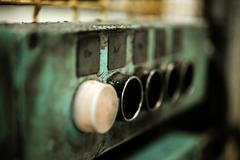 Old and oily buttons of a machine - stock photo