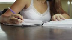 Students doing homework and preparing exam at university, young women writing Stock Footage