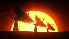 Satellite dishes at sunrise - stock footage
