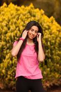 Young beautiful woman enjoying with headphones outdoors Stock Photos