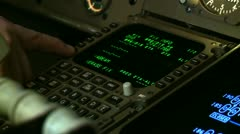 Pilot pushes buttons on Flight Instruments Stock Footage
