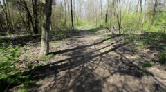 Running down path in woods Stock Footage