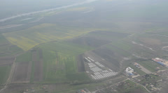 Plane flying, fields and river Stock Footage