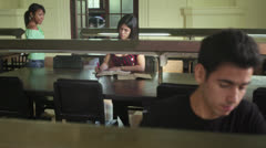 Young people at school, male and female students studying and doing homework - stock footage