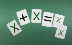 School card with math problems on the green background Stock Photos