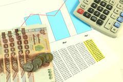 Accounting desktop and coin. Stock Photos