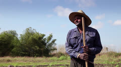 Farmers, agriculture, Cuban peasant in the field, hands holding shovel Stock Footage