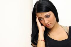closeup portrait of young woman looking depressed - stock photo