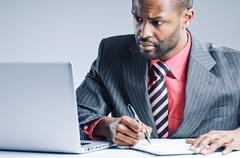 young african american businessman using laptop - stock photo