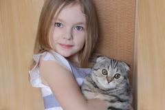 girl with grey kitty - stock photo