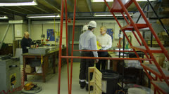 Staff members in a busy warehouse, each carrying out their own roles Stock Footage