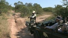 Elephant and safari vehicle Stock Footage