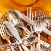 Cutlery and dishware washed under a water stream Stock Photos