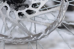 Melting snow on disc brake - time lapse - stock footage