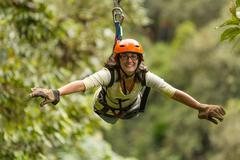 Zip Line Adventure In Ecuadorian Rainforest Banos De Agua Santa - stock photo
