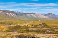 Stock Photo of highway through mountains icelandic landscape