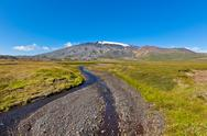 Stock Photo of summer iceland landscape with mountains and small river stream