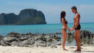 Loving couple on the beach Stock Footage
