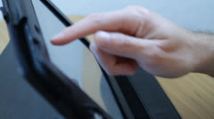 Male hand working on tablet computer selective focus Stock Footage