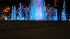 People walk and shooting be photographed night colors lights fountain Stock Footage