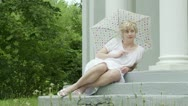 Stock Video Footage of Reclining Parasol Girl