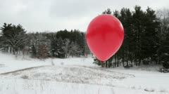 Red Balloon Slide Stock Footage