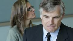 Mature man fired by younger female boss Stock Footage