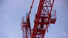 Angular view of top of crane with anemometer Stock Footage