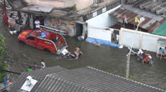 Stock Video Footage of A Motorcycle Pushed Through Flood Waters p184