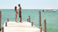 Loving couple on the beach Stock Footage