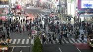 People crossing Shibuya pedestrian scramble in Tokyo city, Japan Stock Footage