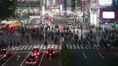 People finish to cross Shibuya pedestrian scramble in Tokyo city, Japan Stock Footage