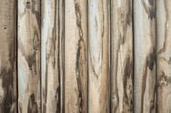 Stock Photo of background wooden wall made from vertical logs