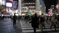 Tourists photographing on Shibuya pedestrian scramble in Tokyo city, Japan Stock Footage