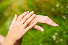 Beautiful female hands Stock Photos