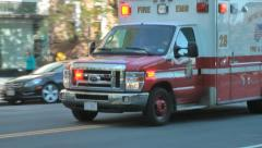 EMS Ambulance passes, turns, siren beeping in Washington, DC Stock Footage