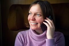 Woman talkning on mobile phone. Stock Photos