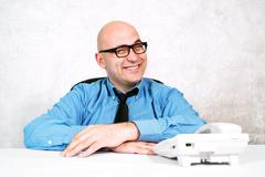 Smiling businessman with telephone Stock Photos