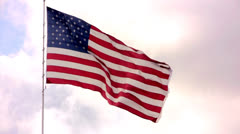 United States flag against clouds Stock Footage