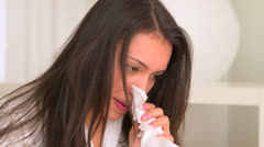 Sick Hispanic woman with tissue in hand Stock Footage