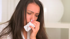 Sick Hispanic woman with tissue in hand - stock footage