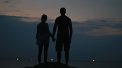 Couple silhouette at the beach. Sunset light. - stock footage
